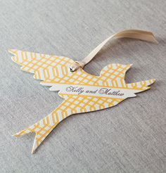 Marinwood letterpress and die cut favor tag by @Dauphine Press in sunshine yellow and charcoal grey.