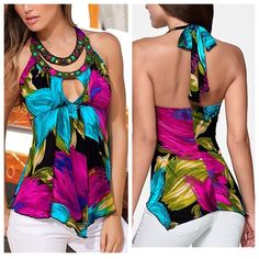 Floral halter top. As shown. Worn once. Like new. Loose fit. Size fits womans 12. Size fits womans large- xtra large. Tops