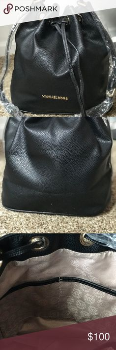 Authentic Michael Kors Leather Drawstring Tote. Authentic Michael Kors Leather Drawstring Tote. Comes with an adjustable strap. Gold ringlets and and metal grommets. It has the Gold Michael Kors name plate, with lots of pockets and space to store items. Very versatile bag. Michael Kors Bags Totes