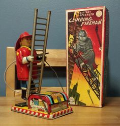 Linemar Climbing Fireman. Battery/Remote toy 60s/ebay