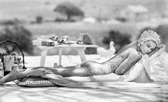 Audrey Hepburn sunbathing.