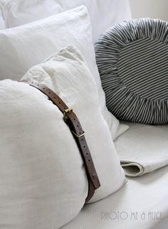 belted cushion @Nicole Novembrino Messick. For your super cute pillows on your couch!