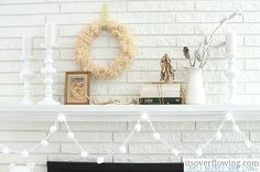 Calm and Cozy Christmas Mantel http://www.itsoverflowing.com/2012/11/calm-and-cozy-christmas-mantel/ #anthropologie #ikea #zgallerie