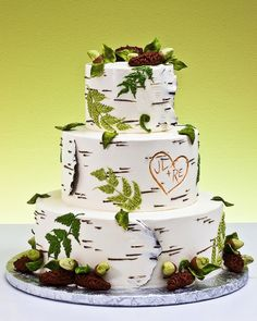 "Birch tree wedding cake. I especially like the initials of the happy couple that are ""carved"" in the tree."