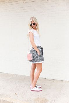 Black and white patterned skirt: http://www.stylemepretty.com/living/2016/09/16/stylish-outfits-to-wear-on-casual-friday/