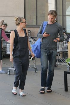 Kaley Cuoco wears Givenchy sandals as she leaves Whole Foods with beau Karl Cook in #LA. #grocerystore #brands #shopping