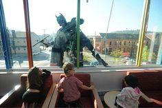 Superheroes Wash Windows at Children's Hospital