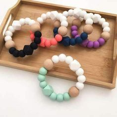 DUO Silicone and Beech Wood Teether - one.three teething baby essentials –todo para bebe ONE. Teething Bracelet, Teething Jewelry, Teething Beads, Diy Teething Toys, Baby Bracelet, Baby Diy Projects, Baby Crafts, Silicone Bracelets, Baby Teethers