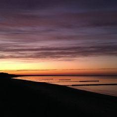Traumhaft schöner Sonnenuntergang in der Bucht von Glowe.