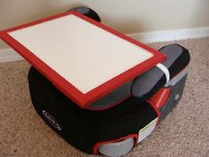 removable car seat trays made out of a thrifted white board and elastic