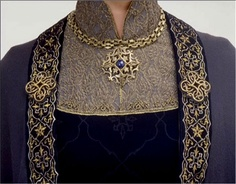 Yoked collar detail of gown and cloak detail