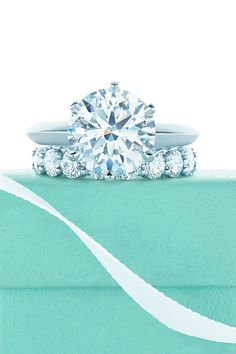 The Tiffany® Setting diamond engagement ring and shared-setting band ring. #TiffanyPinterest
