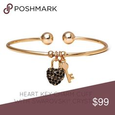 🔜Cuff With Swarovski® Crystal PRODUCT DESCRIPTION:  An encrusted heart and key charm adorned with crystals from Swarovski® decorate this slender goldtone cuff with a sophisticated touch of detail. Jewelry Bracelets