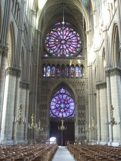 Notre-Dame de Reims Cathedral, Paris, France --- Interior --- Nave looking west showing 2-rose windows.