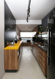 a contemporary black and yellow kitchen softened with light-colored MDF cabinets and with black appliances - DigsDigs Painting Kitchen Cabinets, Kitchen Paint, Home Decor Kitchen, Kitchen Interior, Home Kitchens, Mdf Cabinets, Yellow Kitchen Designs, Kitchen Yellow, Contemporary Home Decor