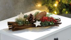 Table decoration for Christmas with bundle of wood holly and pine Christmas Flowers, Christmas Mood, Rustic Christmas, Noel Christmas, Christmas Table Decorations, Diy Christmas Ornaments, Holiday Decor, Art Floral Noel, Deco Table Noel