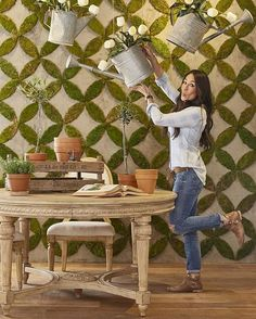 One of my favorite things in the Magnolia Home showroom is this fun moss wall we made and this amazing oval carved table that is available to retailers for my Spring launch at High Point Market next week. Joanna Gaines Blog, Joanne Gaines, Chip And Joanna Gaines, Chip Gaines, Magnolia Fixer Upper, Magnolia Homes, Magnolia Market, Moss Decor, Moss Wall