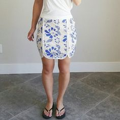 """Endless Rose Blue & White Lace Fitted Mini Skirt Not Topshop. Brand is Endless Rose. Listing due to similarities to the brand. Lace mini skirt in blue. The round-edge panels and front open seams give a lengthened look.  - Self: 80% Cotton, 20% Polyester - Contrast: 97% Polyester, 3% Spandex - Back exposed zipper closure  Medium: L - 18"""", W - 15"""", H - 18.5"""" Fits size 6-8 Topshop Skirts Mini"""