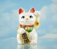 Feng Shui: What Is the Lucky Cat Used For?: The lucky cat, or Maneki Neko is a popular feng shui cure that is actually of Japanese origin. Mostly used as a wealth cure in business, the lucky cat can also be used in your home bagua area related to money.
