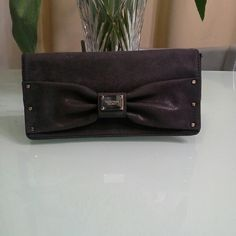 Victoria 's secret  clutch Used but in  good condition.  Color is not black. Its charcoal or you can say dark grey. One zipper pocket outside . Spacious inside. Victoria's Secret Bags Clutches & Wristlets