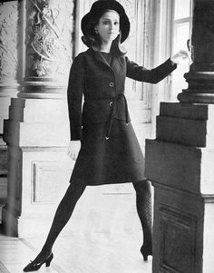 Benedetta in a smooth black wool dress worn under a little fitted jacket with a kid-tied belt by Valentino, photo by Henry Clarke, Vogue UK 1968
