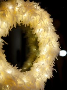Wrap a white boa around a pre-lit wire wreath for a dramatic look.