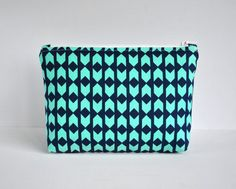 Woman's aqua green chevron arrow padded cosmetics make up pouch Modern print in aqua green in large. by CuriousMissClay on Etsy