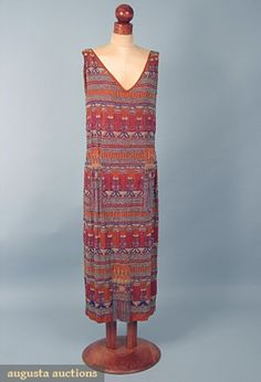 Egyptian revival beaded dress. Multicolor beads form the pattern, ruching at hips.  Augusta-auction.com