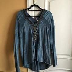 Free People Beaded Long-Sleeve Shirt Beautiful shirt that's been one of my favorites. Good condition: there's a little rip in the mesh on the back of the shirt (can be fixed) Price reflects flaws. Open to offers! Free People Tops Tees - Long Sleeve