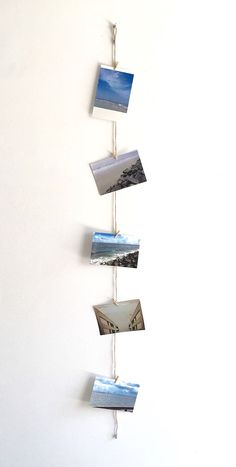 Display your favorite photos with this unique twine photo clip string set. This photo holder is perfect for displaying your childs artwork, pictures, cards, etc. It is a great way to display multiple photos in an area with limited wall space. It makes the perfect addition to any home, office, business or dorm room. The twine pictured in this photo measures 4 feet long. 5 mini wooden clothes pins are included, handle with care. ** If you would like to purchase additional clothespins with your…