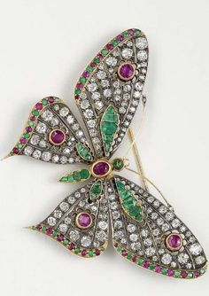 An Antique Diamond Emerald and Ruby Butterfly Brooch 1890 The vari-cut emerald and sapphire body extending old-cut diamond wings accented by circular-cut emeralds and rubies set en tremblant mounted silver and gold length 3 inches. Antique Brooches, Antique Rings, Or Antique, Antique Jewelry, Vintage Jewelry, Antique Locket, Insect Jewelry, Butterfly Jewelry, Animal Jewelry