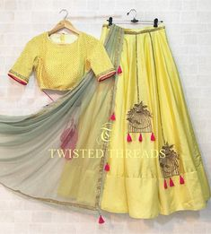 Beautiful raw silk yellow lehenga with zardozi birdcage motif. It comes with a yellow thread and sequins work blouse. Lehenga Choli Designs, Indian Lehenga, Half Saree Designs, Blouse Designs, Indian Wedding Outfits, Indian Outfits, Wedding Dress, Wedding Hairs, Wedding Updo