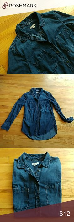 Merona denim button up shirt Dark wash denim long sleeve button up shirt by Merona. Slight Hi-Lo hem. Really great staple but just too tight for me in the shoulders. Merona Tops Button Down Shirts