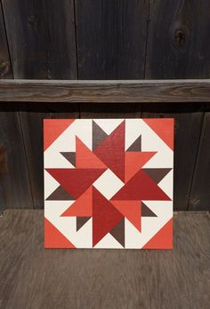 We hand painted this barn quilt on 1/2 thick exterior grade plywood. We used weather resistant primer and quality outdoor paints. We then used