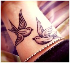 Jodi I want this tattoo, like yesterday. The two birds will always be together, lovingly looking out for one another.