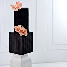 All black pearl wedding cake with blush flowers on satinice.com!