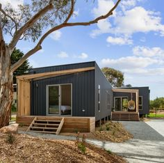 The Heyley Project is located beachside on Phillip Island Victoria. Adopting passive solar principles and maximising the site orientation the home achieves a 7-star energy rating and nestles beautifully into its natural setting. 📷 @coastalsnaps Freestanding Fireplace, Phillips Island, Open Living Area, Passive Solar, Beach Shack, Lodges, Tiny House, Beach House, Shed