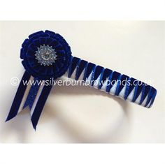 Navy velvet, royal satin and white edged silver satin sharkstooth shown detailed with coloured crystals and standard swallowtail flags  www.silverburnbrowbands.co.uk
