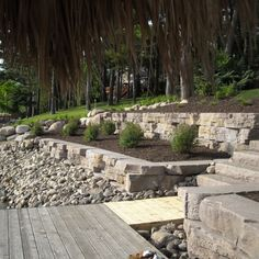 Landscaping and sea walls by Todd's Services creating an artistic shoreline
