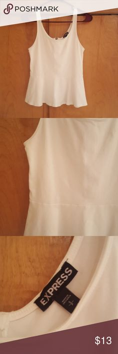 White Peplum Express Tank Top I have this classy white peplum top from Express. There are no stains or sign of wear. I wore this once for any event last year. Super stretchy and comfortable to wear! Express Tops Tank Tops