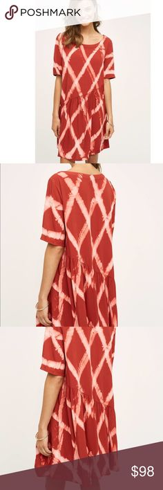 """ANTHRO THE ODELLS Riya swing dress NWOT The Odells for Anthropologie Riya swing dress. Women's size M. Red tie dye detail. Hand dyed so has some imperfections.  100% rayon. Asymmetrical waistline.  Measurements: 21"""" across bust, 36"""" shoulder to bottom.  No modeling. Open to reasonable offers! Bundle & save 10%! 💕 Anthropologie Dresses"""