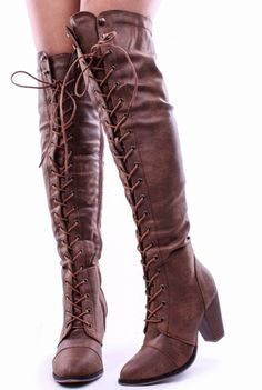 These vegan leather boots feature a lace up design all the way to top to just above the knee. With a slightly pointed/round toe and 2 inch block heel, these are practical for casual wear or a night ou