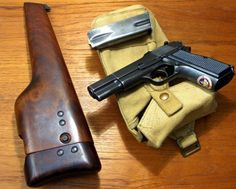 Canadian Inglis Pistol with Shoulder Stock. This was a re-engineered design of the Browning Hi-Power. Note the maple leaf decal.