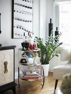 9. Drink from a well-stocked bar cart that no longer contains plastic party drinkware.