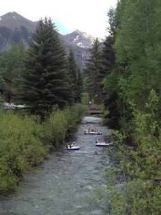 Tubing down the San Miguel River is a great way to cool of in the summer in #Telluride! Photo property of the Telluride Tourism Board.