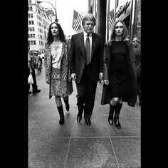 #DonaldTrump and two models walking down the street in #NYC. The billionaire #realestate mogul participated in the #GOP presidential #debate last night. ( Bruce Gilden/Magnum Photos) by magnumphotos