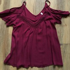 Open shoulder Burgundy Crotchet Top The shoulders are open, great for summer! The center has crochet so great for dressing up as well! It is not tight, loose style! Tops Blouses