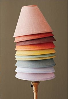 Liven up boring white lampshades. Brushed with diluted fabric dyes, and then line the shade with silver or gold paper. From Little Green Notebook.
