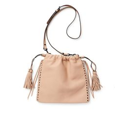 Rebecca Minkoff drawstring crossbody-NWT Rebecca Minkoff Moto drawstring crossbody - NWT. Color is latte -  a gorgeous pinky/peach nude that goes with everything. Features fringe tassels, drawstring closure, adjustable strap, and intricate lace-up detail. Interior slip pocket. Genuine leather.  Truly awesome bag! SOLD OUT!  Price is firm. 🎉3 X HP! Street Style 6/5/16, Statement Style 6/23/16, Best in Bags: 7/23/16🎉 Rebecca Minkoff Bags Crossbody Bags