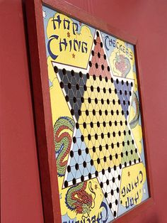 Affordable art, colorful old board games. This is a vintage Chinese checkers board.